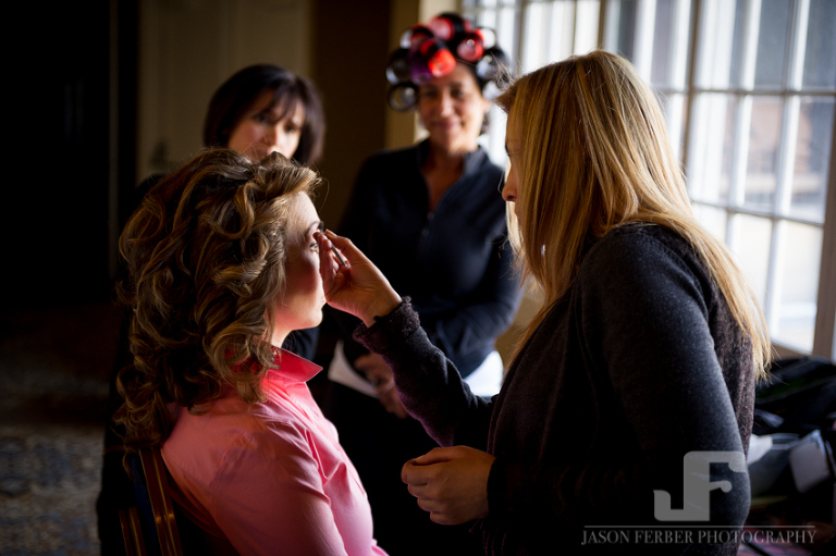 Bride getting ready with family watching