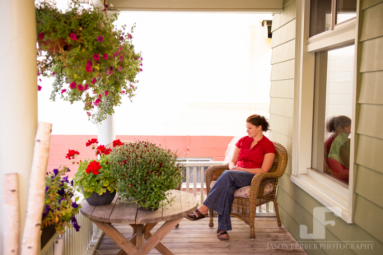 Quiet moment bride on porch while getting ready
