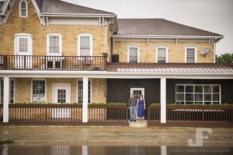 Couple holding hands on covered porch